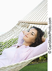 Woman in hammock. - Portrait of pretty young adult Caucasian...