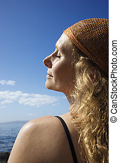 Peaceful woman at coast - Profile of Caucasian mid-adult...