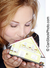 woman kisses her house