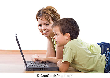 Mother and child surfing the net together - Child surfing...