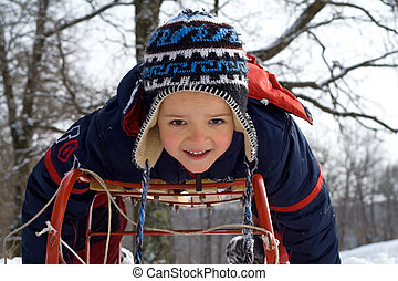 Little boy on a sledge