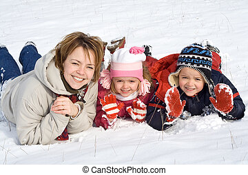 Family in the snow - Family having fun in the snow