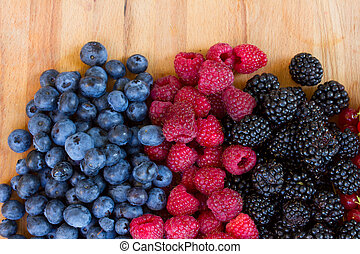 ripe of fresh berries on table - ripe of fresh raspberry,...