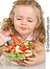 Little girl eating fruit salad - Little girl with fruit...