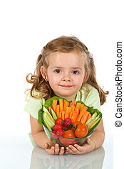 Little girl holding a bowl of vegetables