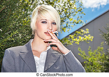 Business woman smoking in the break