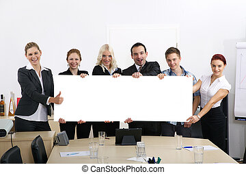 Business people holding banner high