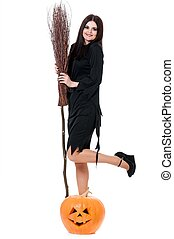 Sexy witch - Young sexy witch with broom and pumpkin over...