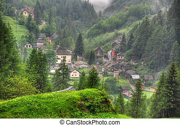 Alpine village with green trees
