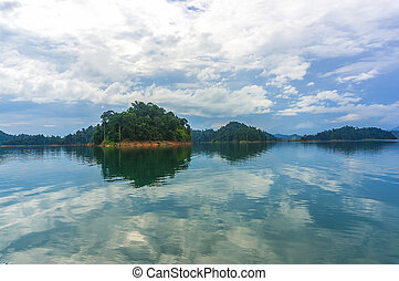 Reflection of rain forest at Kenyir lake, Malaysia