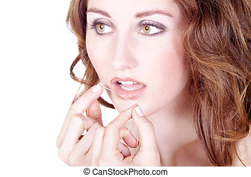 young woman with dental floss
