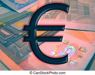 Euro mark and euro banknotes at the background