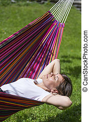 Woman in a hammock - Woman relax in a hammock