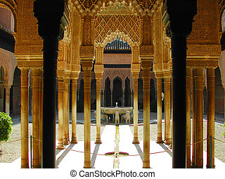 Columns and arch with lion fountain in Alhambra, Granada,...