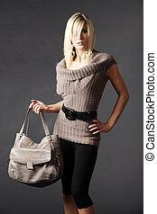 Pretty woman in fashion with handbag