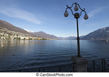 Alpine lake and a street lamp - Alpine lake with a street...