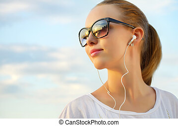 listening to music - Teenage girl listening to music...