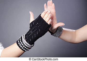 women with glove clapping from
