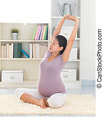 Woman doing relaxation yoga at home