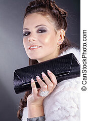 pretty woman with clutch bag