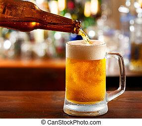 beer pouring into mug
