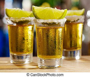 glass of tequila with lime
