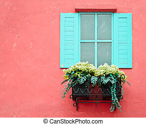 Window with flower pots - Window on the red wall with copy...