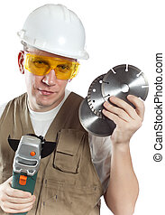 The man in working overalls in goggles and a helmet