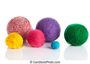 colorful different thread balls. wool knitting on white...