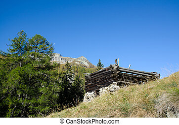 Broken rustic house and mountains - Broken rustic house and...