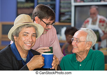 Handsome Mature Men in Bistro - Diverse trio of adult men in...