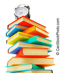 Multi-coloured books and alarm clock on the white.