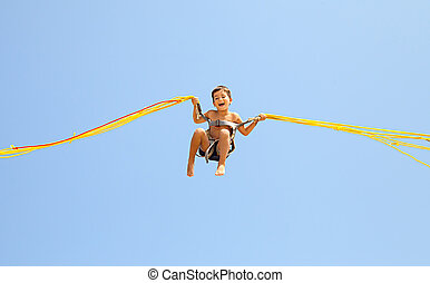 Boy jumping on trampoline - Little boy jumping on a...