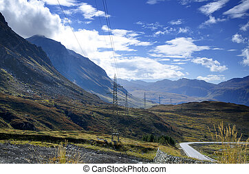 Electricity pole over the mountain with blue sky and clouds