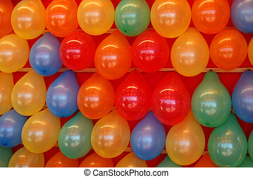 Brightly Colored Balloons - Rows of brightly colored...