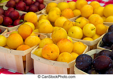 ripe plums at the market