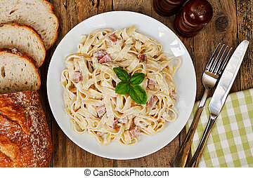 traditional italin food - top view of a plate of tagliatelli...