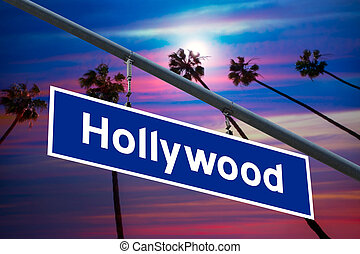 Hollywood California road sign on redlight with pam trees...