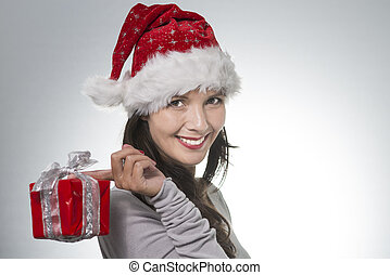 Beautiful young woman in a Santa Hat with a decorative...