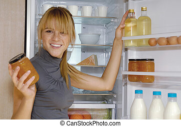 woman looking in the fridge vp - Mature woman looking for...
