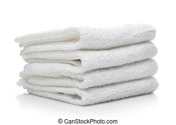 Stack of white hotel towels on a white background