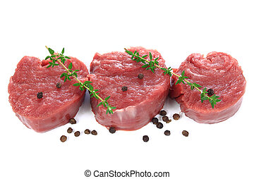 Sirloin steak - Raw sirloin steak with pepper on a white...