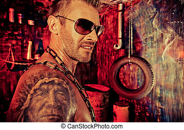 tattoo man - Portrait of a handsome muscular man in the old...