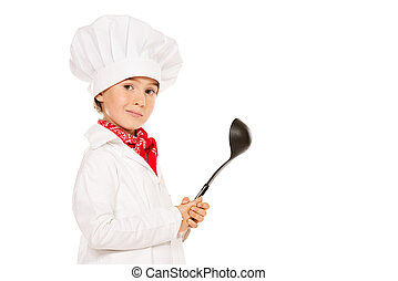 cook with ladle - Portrait of a little boy cook holding a...