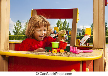 Playing with sand on playground
