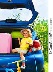 All you need for car vacation - Nice little 3 years old boy...
