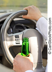 Woman drinking while driving - Close up view of the hand of...