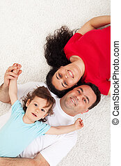 Young family with child relaxing