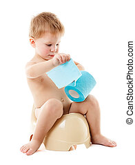 Baby on the chamber pot with toilet paper