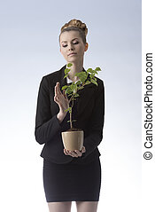 happy businesswoman with money plant - elegant successful...